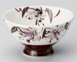 アメ釉花紋飯碗